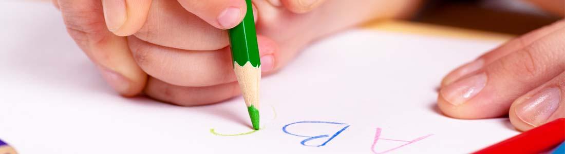 Preschooler writing alphabet